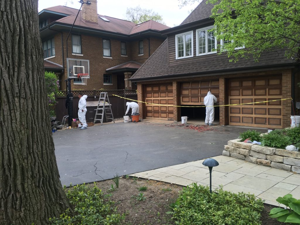 men working on a garage