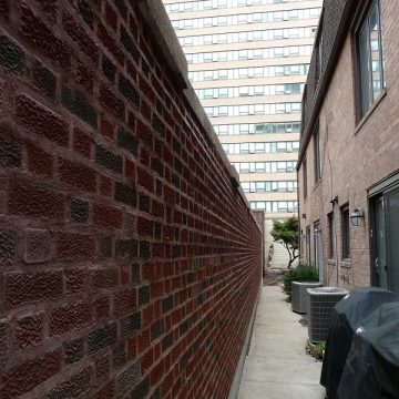 long view of brick wall
