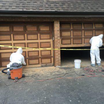 men renovating garage doors