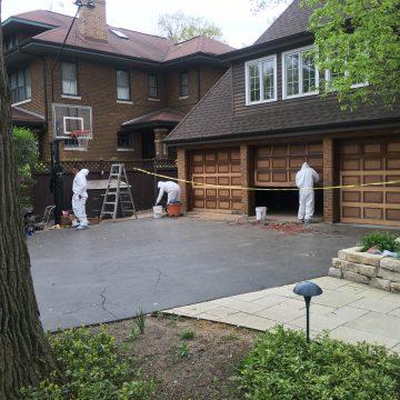 men working on a garage
