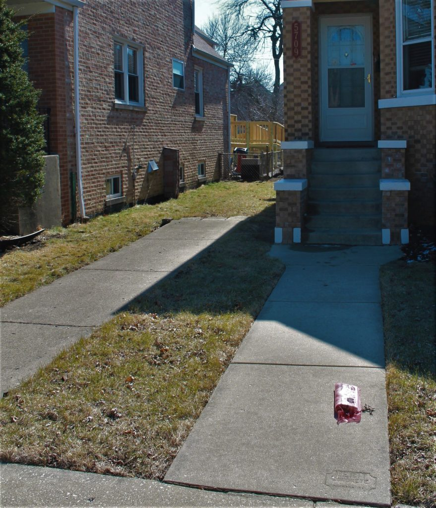 driveway and sidewalk exterior of house