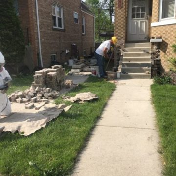 Sideways picture of brick work being done outside front door