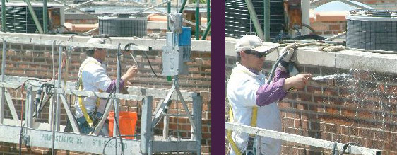 Man on crane adding mortar to bricks