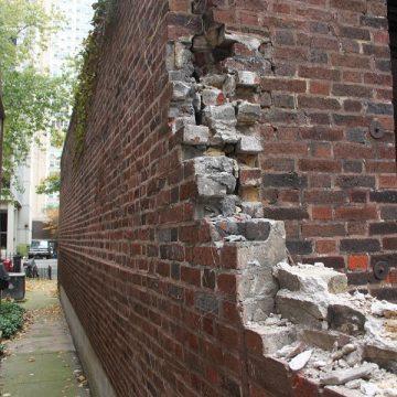 Damaged brick wall