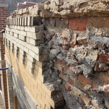 brick work on a damaged roof