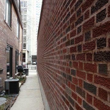 brick wall and a sidewalk