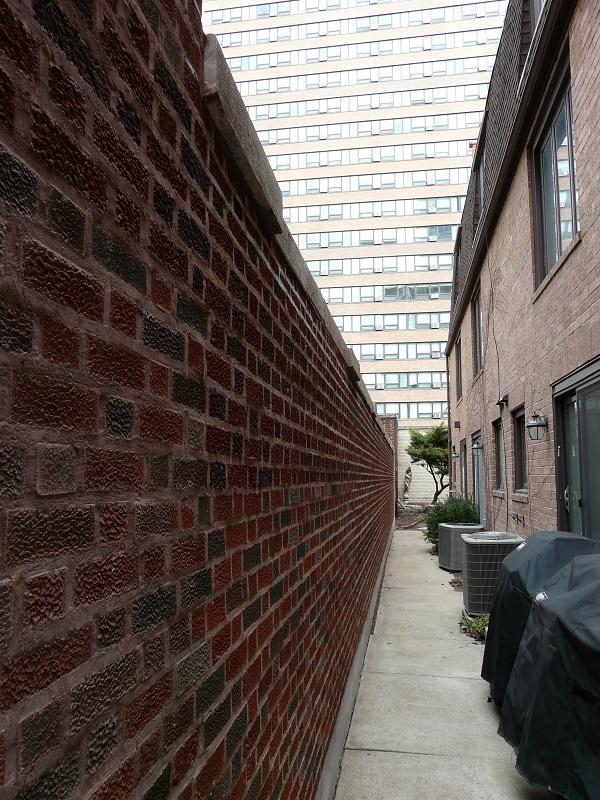 long view of brick wall